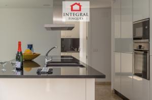 Les appareils sont intégrés selon le design de la cuisine.
