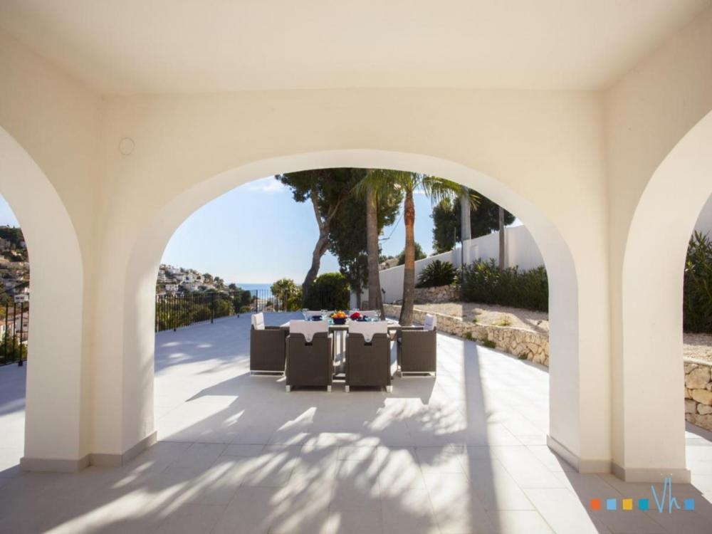 Villa ALOSA in Benissa with a partially covered terrace and sea views