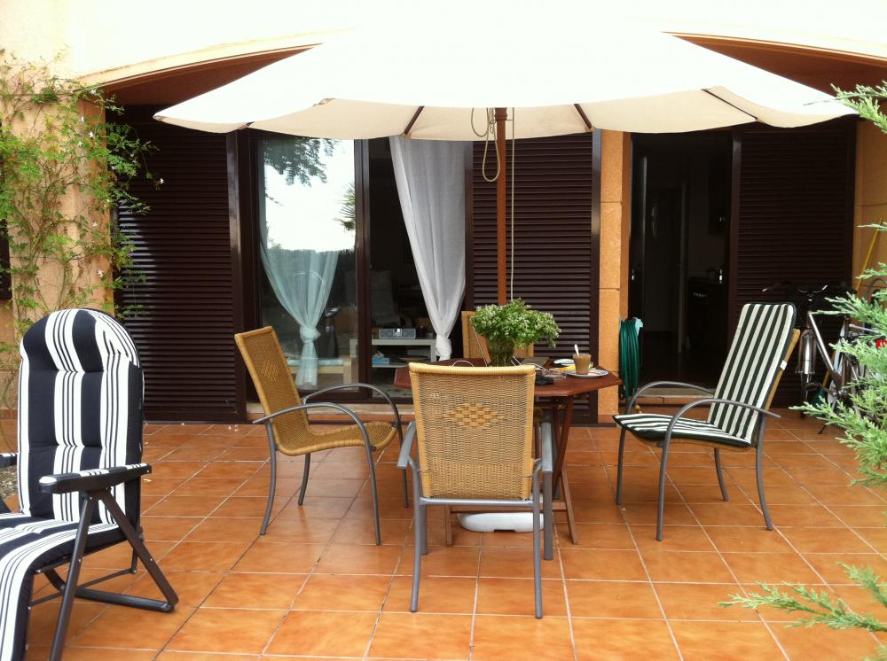 Terrace with garden furniture and parasol